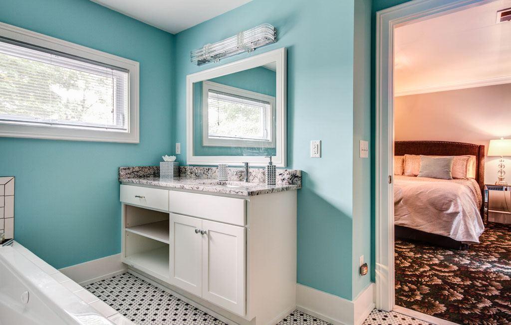 Bathroom Vanity and Bedroom in Background