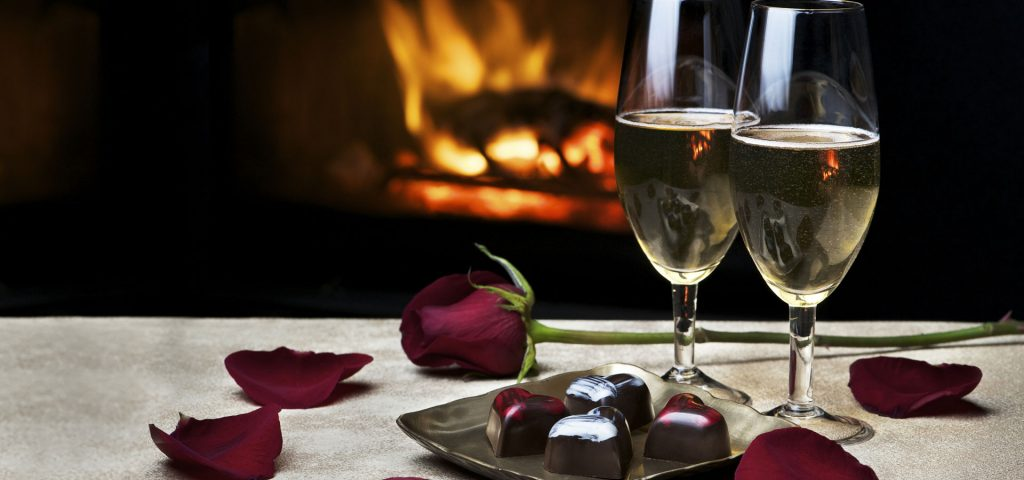 Champagne, chocolates and rose petals