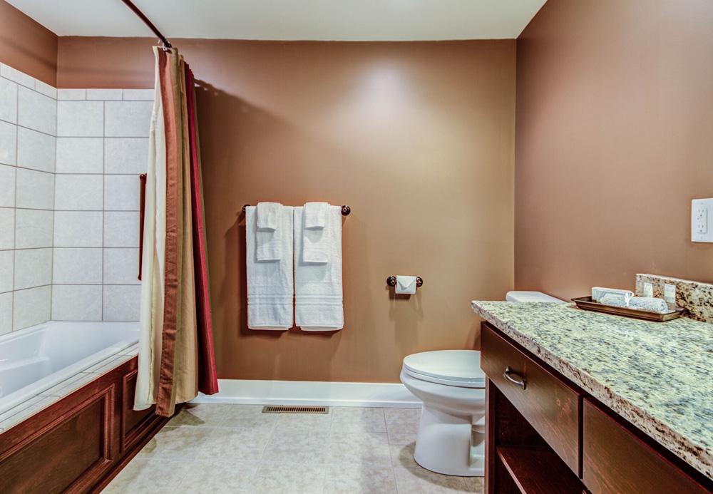 Vanity and whirlpool tub in Chelsea Room bath