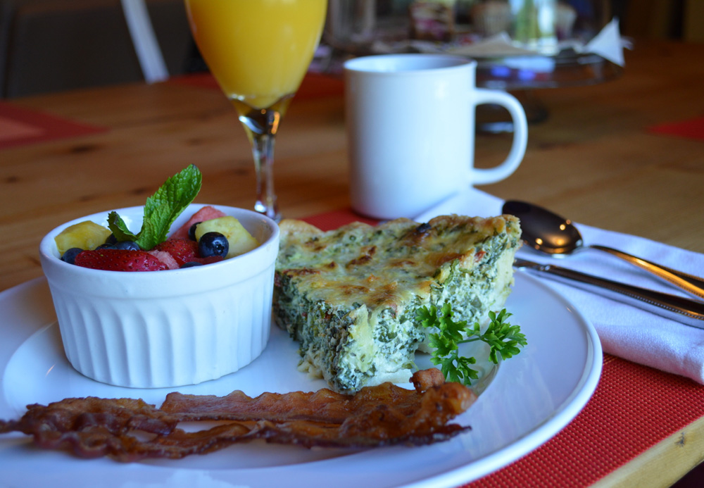 Spinach and feta quiche with fresh fruit and bacon