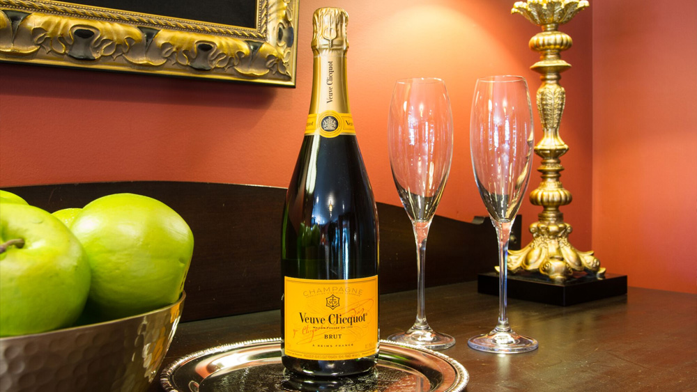 Bottle of Veuve Clicquot champagne and two champagne glasses